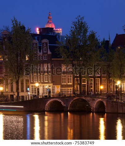 One of the famous canals of Amsterdam, the Netherlands at dusk. - stock photo