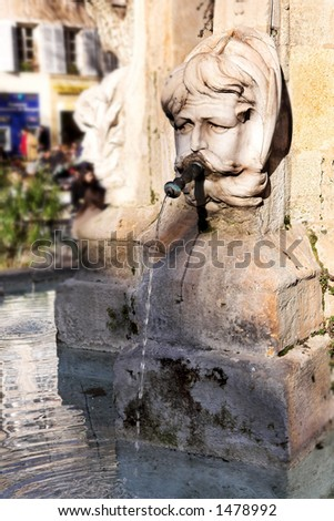 One of the famous water fountains in Aix-en-Provence, France - stock photo