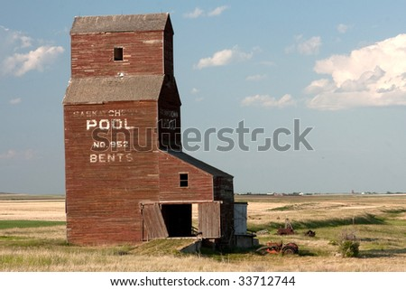 One of the few remaining Saskatchewan Landmarks, Wooden grain elevators used to dot the prairie landscape but most have been torn down and replaced by concrete Terminals. - stock photo