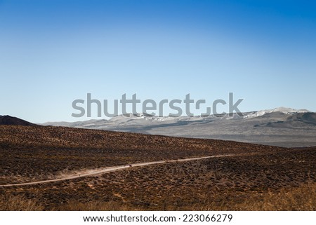 One of the few stretches unpaved of road 40 in Argentina. - stock photo