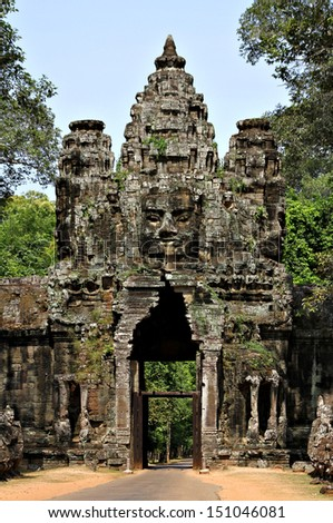 One of the gates to Angkor Thom, near Siem Reap, Cambodia. - stock photo