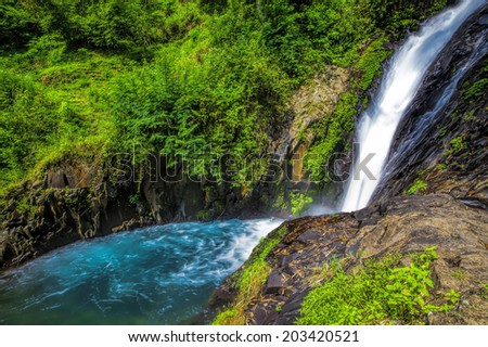 One of the Gitgit waterfalls in Northern Bali, Indonesia - stock photo