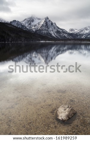 One of the high mountains around Lake Stanley in winter near Sun Valley Idaho Sawtooth Mountain Range - stock photo