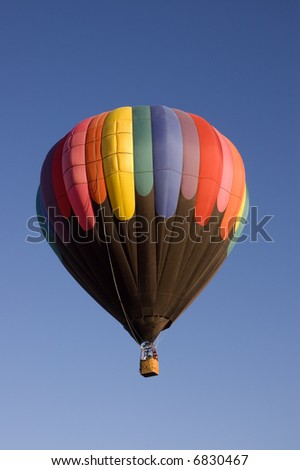 One of the many balloons at the Taos balloon festival rising at dawn