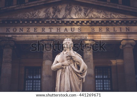 One of the many beautiful statues seen in Berlin, Germany located at the Gendarmenmarkt. - stock photo