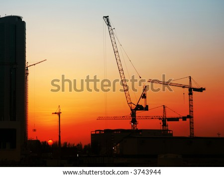 One of the many building sites in the West Bay district of Doha, Qatar, at sunset during the construction boom of 2007 - stock photo