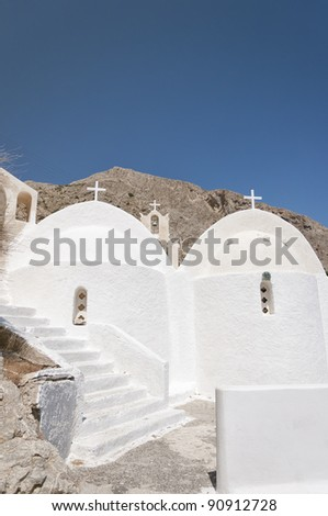 One of the many churches that adorn the greek island of santorini.