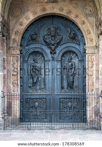 One of the many doors of Quito's Cathedral, Ecuador. - stock photo