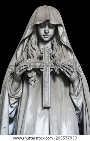 One of the many statues located in the cemetery of Genova Staglieno. Una delle tante statue situate nel cimitero di Staglieno a Genova. - stock photo
