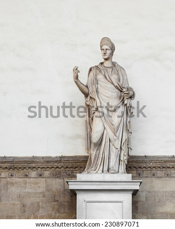 One of the many statues outside the Uffizi gallery in Florence, Tuscany. - stock photo