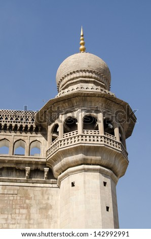 One of the minaret towers at the historic Mecca Masjid mosque in Hyderabad, India. - stock photo