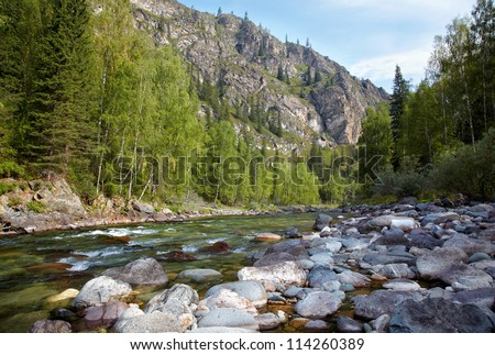 One of the most beautiful mountain rivers of Altai Kumir - stock photo