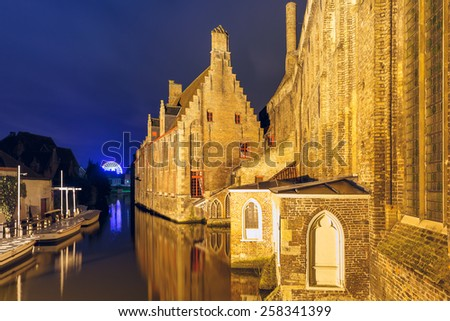 One of the most famous and beautiful sights view in Bruges - Night view Hospital of St. John, Belgium. - stock photo