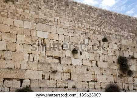 One of the most sacred places to the Jewish people - the Wailing Wall in the old city of Jerusalem, Israel. - stock photo