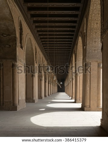One of the passages surrounding  the courtyard of a historic mosque, Cairo, Egypt - stock photo
