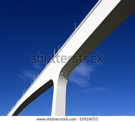One of the several bridges over Douro river in Porto, Portugal, against deep blue sky. This one is one of the newest ; reinforced concrete - stock photo