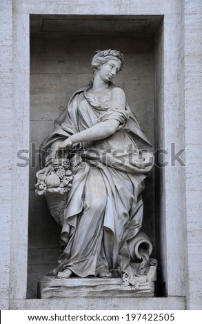 One of the statues on the Palazzo Poli in Rome, Italy - stock photo
