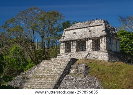 One of the temples in the ruins of the ancient Mayan city of Palenque, Mexico - stock photo