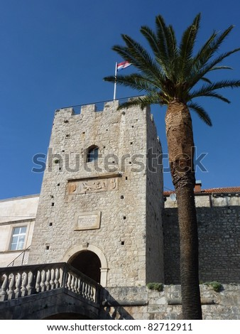 One of the towers in the ancient city wall of the historic city Korcula at the island Korcula in Croatia - stock photo