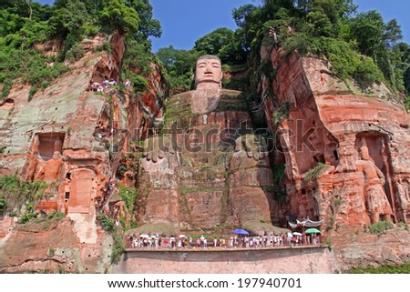 One of the world's largest budga statue in Leshan, Sichuan, China (it is carved out of mountain and 71 meter tall)  - stock photo