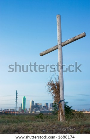 One of three crosses on a hill with a view of the skyline of the city of Dallas, Texas to the north.