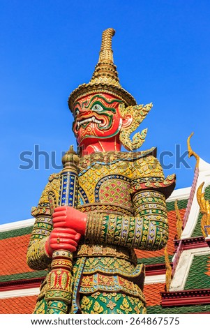 One of twelve giant guardians, characters from the Thai Ramakien epic, guarding the gate of Wat Phra Kaeo. Bangkok, Thailand - stock photo