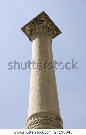 One old classic column isolated on  blue sky
