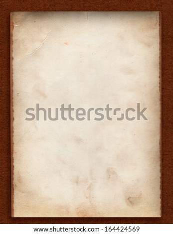 One old photo paper back side grunge with space for text or image  isolated with clipping path on dark brown cardboard background - stock photo