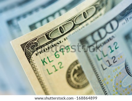 One old type hundred dollar banknote among new ones - stock photo