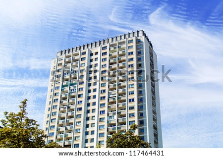 one older high-rise apartment building. live in high-rise - stock photo