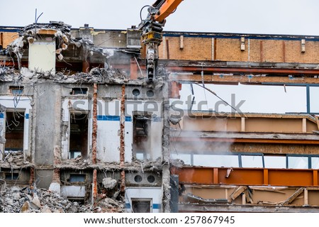 one older office building will be demolished to make way for a new building - stock photo