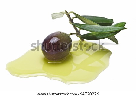 One olive with leaves on some olive oil isolated on a white background.