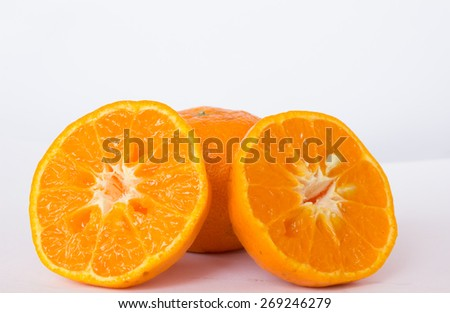 One orange with two halves of oranges with isolate background - stock photo