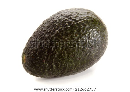 one organic avocado on a bright background