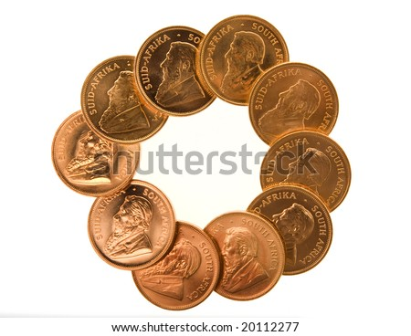 One Ounce gold Krugerrand coins from South Africa isolated on white. - stock photo