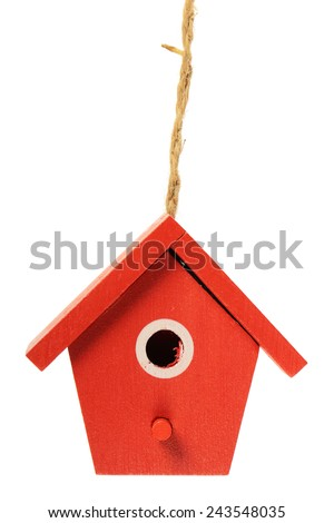 One painted birdhouse hanging on white background - stock photo