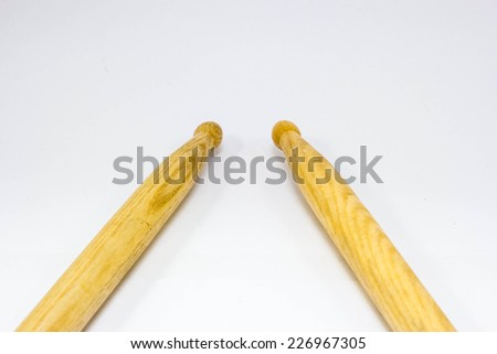 One pair of drum sticks on white  background - stock photo