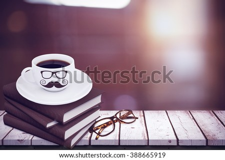 One pair of glasses against close-up of digital tablet and coffee on table Close-up of digital tablet and coffee on table in the coffee shop - stock photo