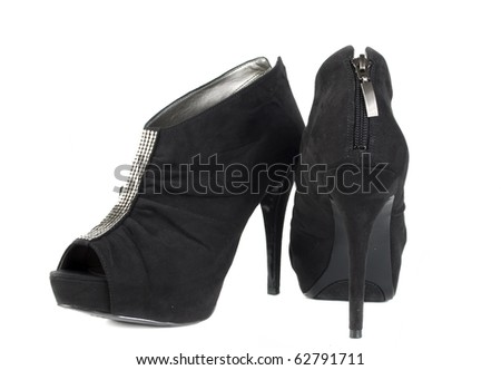 One pair of  very modern black wonan shoe isolated on the white.