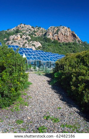 one path leading to a field of new alternative energy production - stock photo
