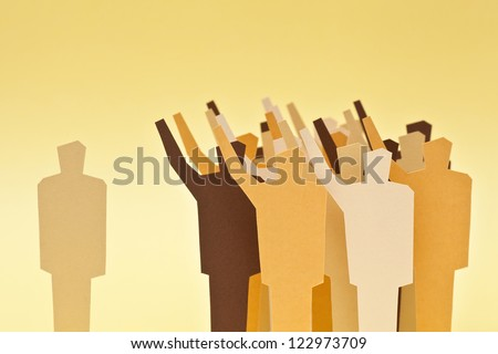 One person leaving the crowd because of his disagreement with the majority - stock photo