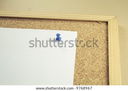 one piece of plain white notepaper on a cork board background - stock photo