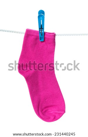 One pink sock hanging on the clothesline. Image isolated on white background   - stock photo