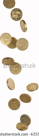 one pound coins shot as if aflling from above - stock photo