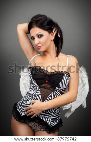 One pretty young woman in sexy lingerie - stock photo