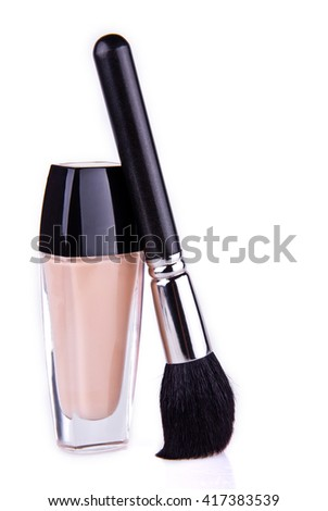 One professional make up brush and cream in jar. Good for articles. Place for your text. Isolated.