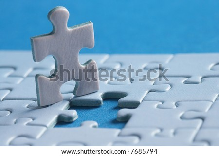 one puzzlepart out of the puzzle aufzählen - stock photo