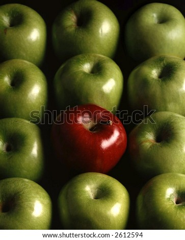 One red apple among the green apples - stock photo
