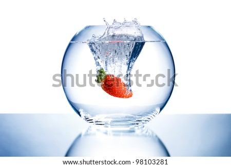 one red beauty big  strawberry  drop in blue water with splashes; on white background, isolated