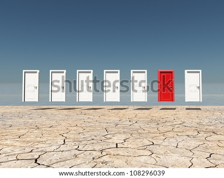 One red door among several floating doors in dry cracked landscape - stock photo